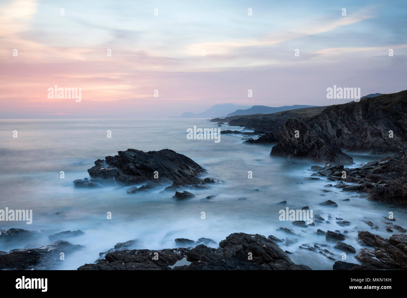 Sunset over the coast of Achill Island, a destination on Irelands Wild Atlantic way, County Mayo Ireland - Stock Image