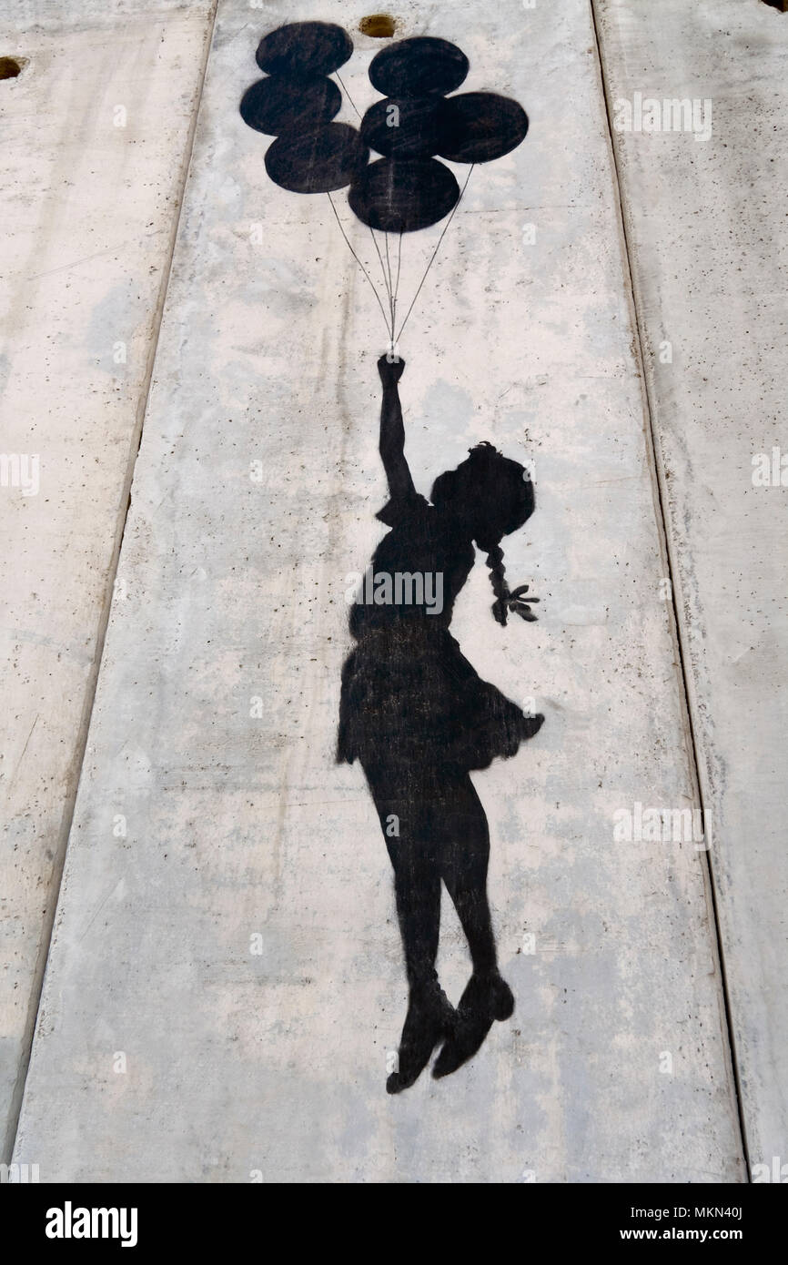 A banksy graffiti on the separation wall, Palestine - Stock Image