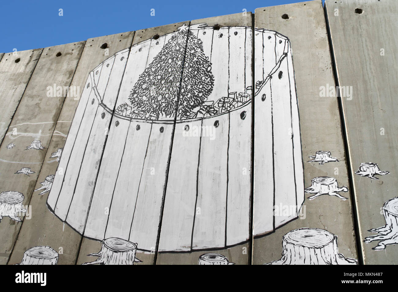 A banksy graffiti on the separation wall, Bethlehem, Palestine - Stock Image