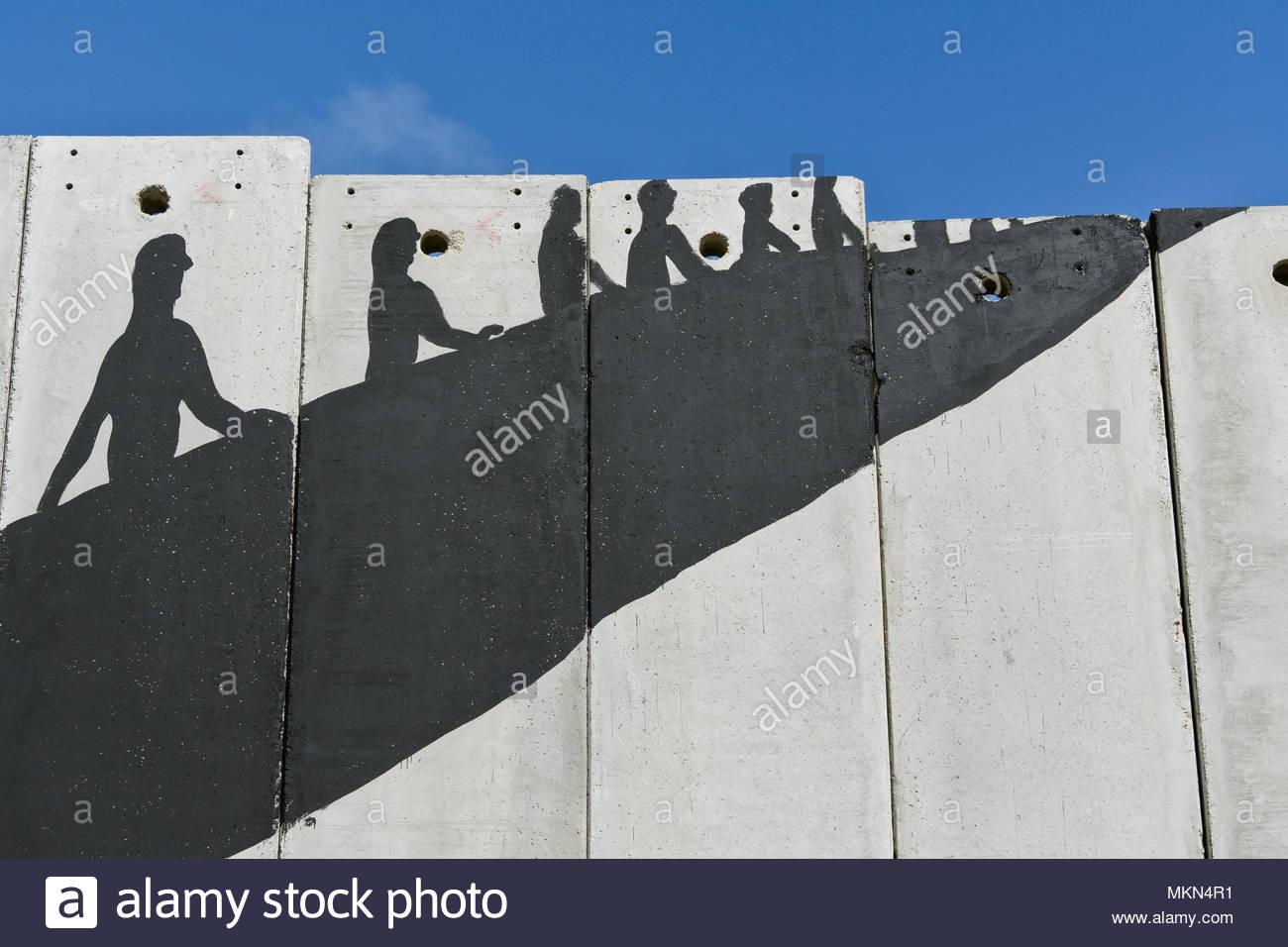 A banksy graffiti on the separation wall,Bethlehem, Palestine - Stock Image