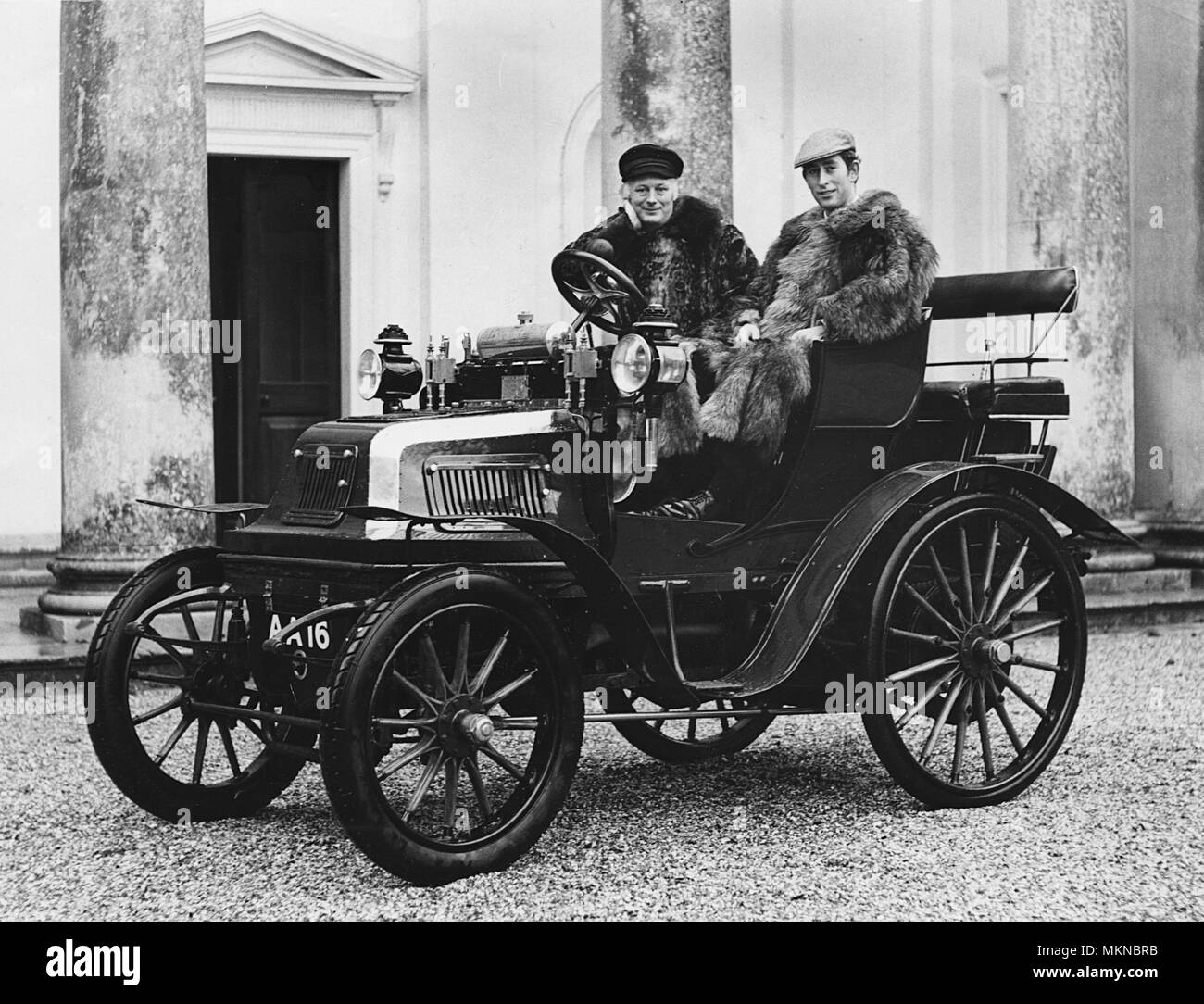 1899 Daimler with Lord Montagu and Prince Charles (1970). - Stock Image