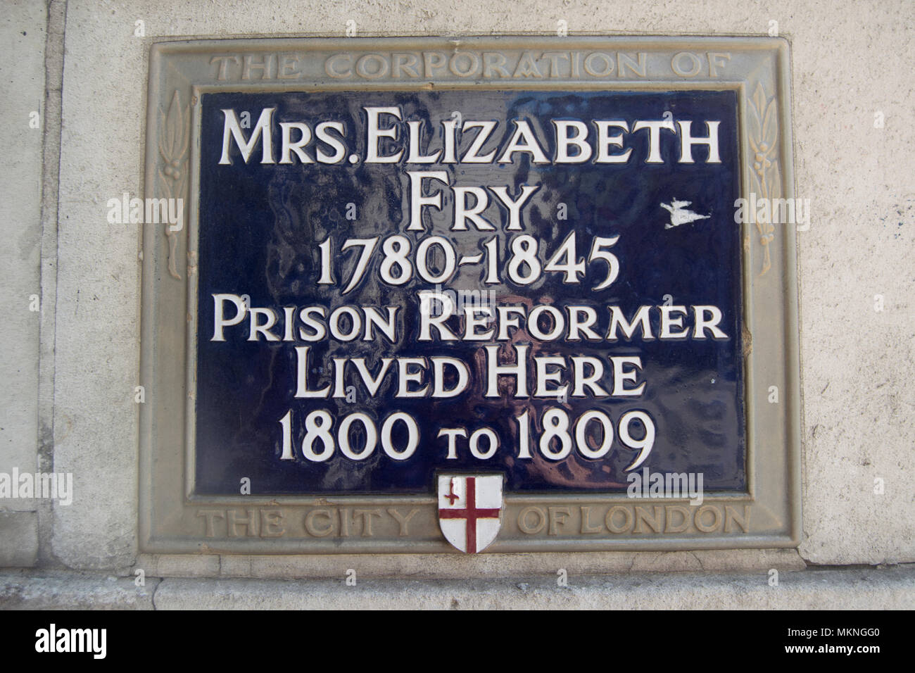 city of london blue plaque marking the early 1800s home of prison reformer elizabeth fry - Stock Image