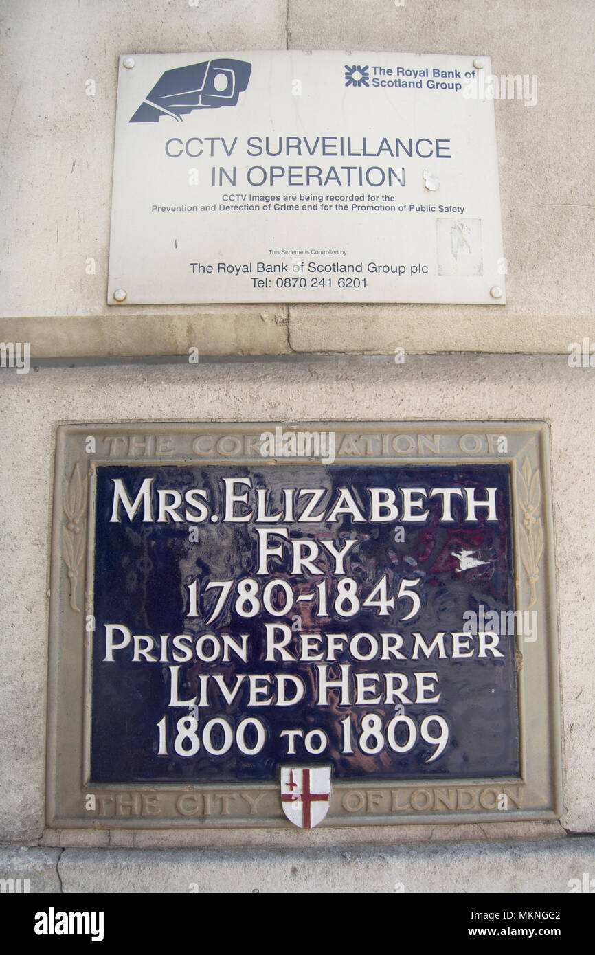 city of london blue plaque marking the early 1800s home of prison reformer elizabeth fry below sign warning of cctv use - Stock Image