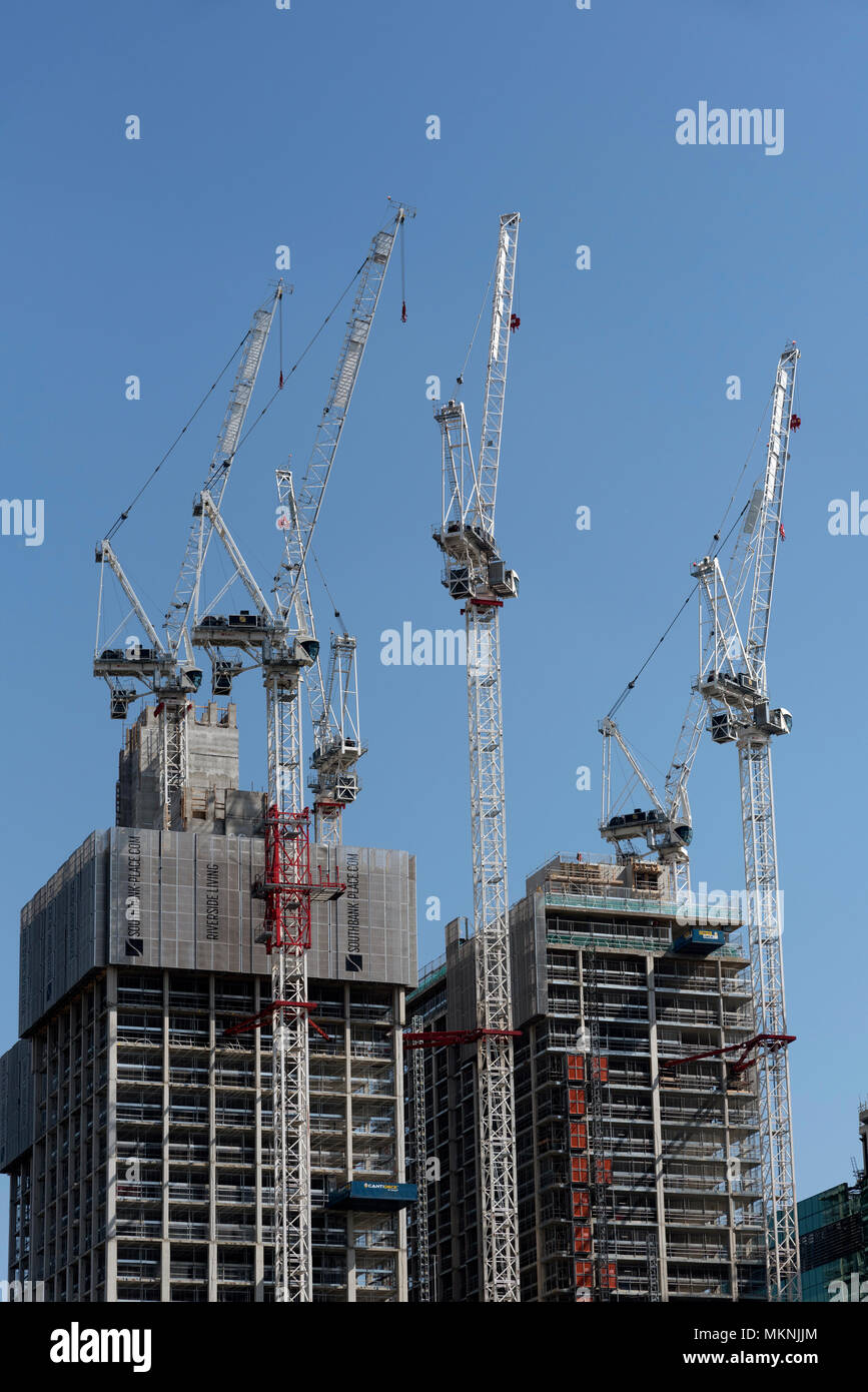 South Bank, London UK. Luffing Jib tower cranes working on the site of the 1951 Festival of Britain. Building residential and commercial properties. - Stock Image