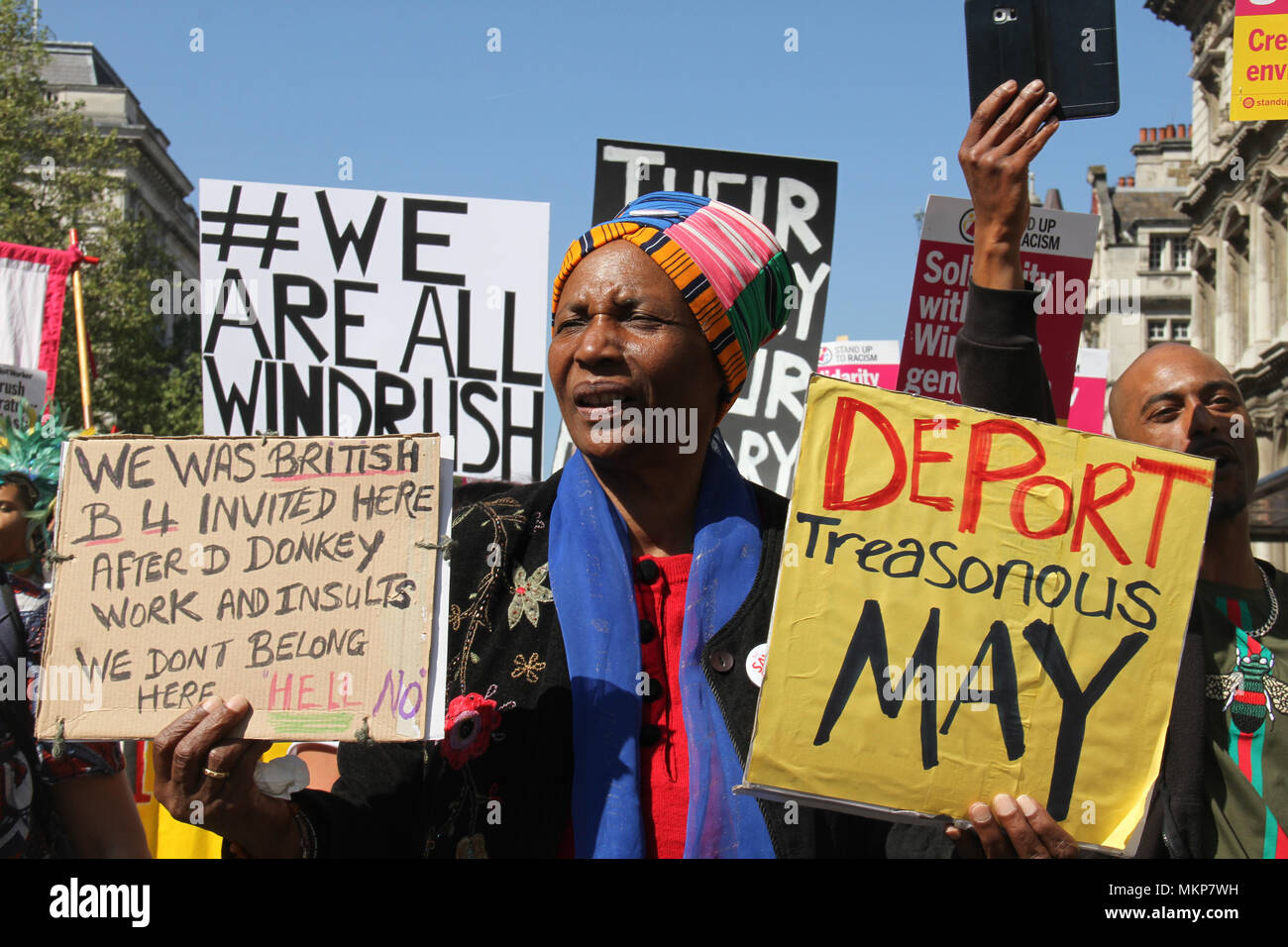 """Whitehall, London- UK: 5 May 2018. Hundreds of people joined the March for Windrush at Whitehall on 5th May, to protest against the """"Hostile environment"""" that has targeted the Windrush generation. A generation of people who were invited from Commonwealth countries as UK citizens have been subject to deportation from  the UK. Credit: David Mbiyu /Alamy Live News - Stock Image"""