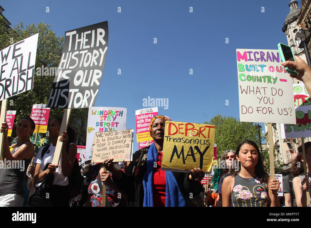 """Whitehall, London- UK: 5 May 2018. March for Windrush demonstrators seen during a demonstraion outside to the Home Office on 5th May, to protest against the """"Hostile environment"""" that has targeted the Windrush generation. A generation of people who were invited from Commonwealth countries as UK citizens have been subject to deportation from  the UK. Credit: David Mbiyu /Alamy Live News - Stock Image"""