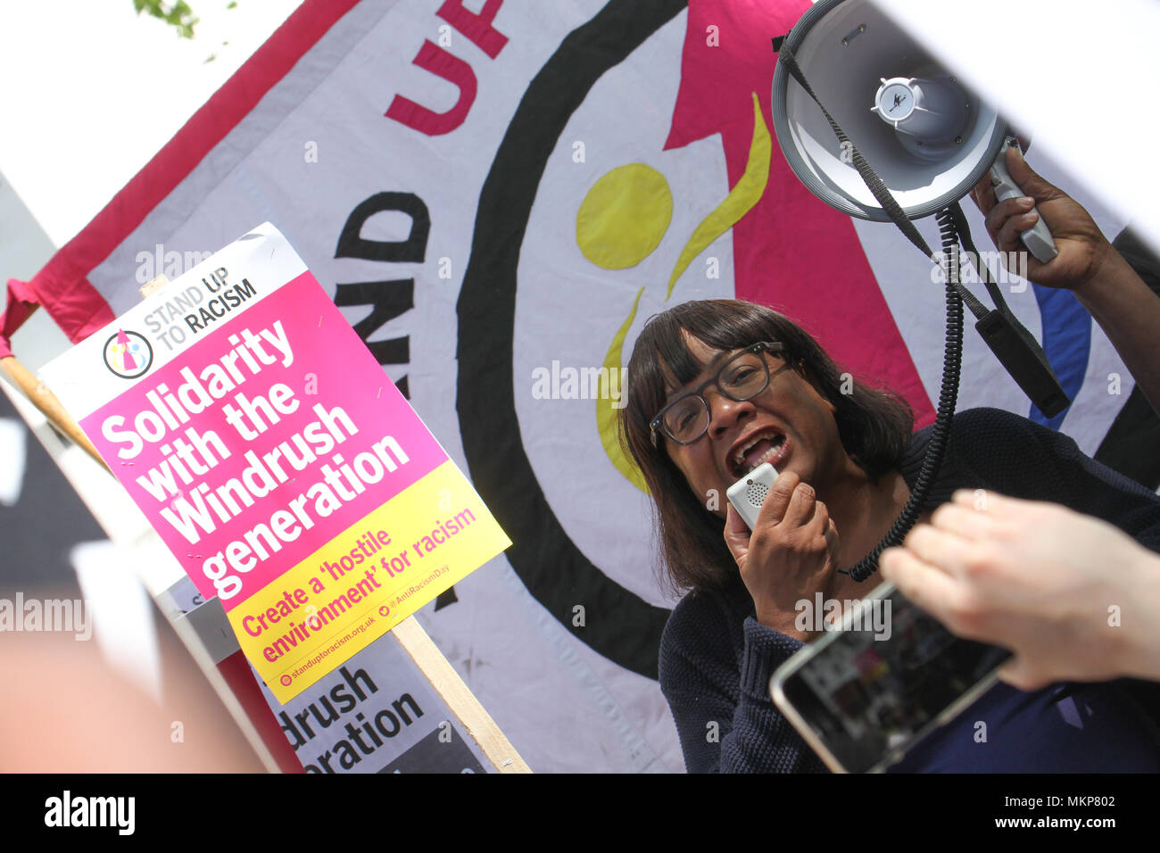 """Whitehall, London- UK: 5 May 2018. Shadow home secretary  Diana Abbot talk during a the March for Windrush demonstraion at Whitehall on 5th May, to protest against the """"Hostile environment"""" that has targeted the Windrush generation. A generation of people who were invited from Commonwealth countries as UK citizens have been subject to deportation from  the UK. Credit: David Mbiyu /Alamy Live News - Stock Image"""