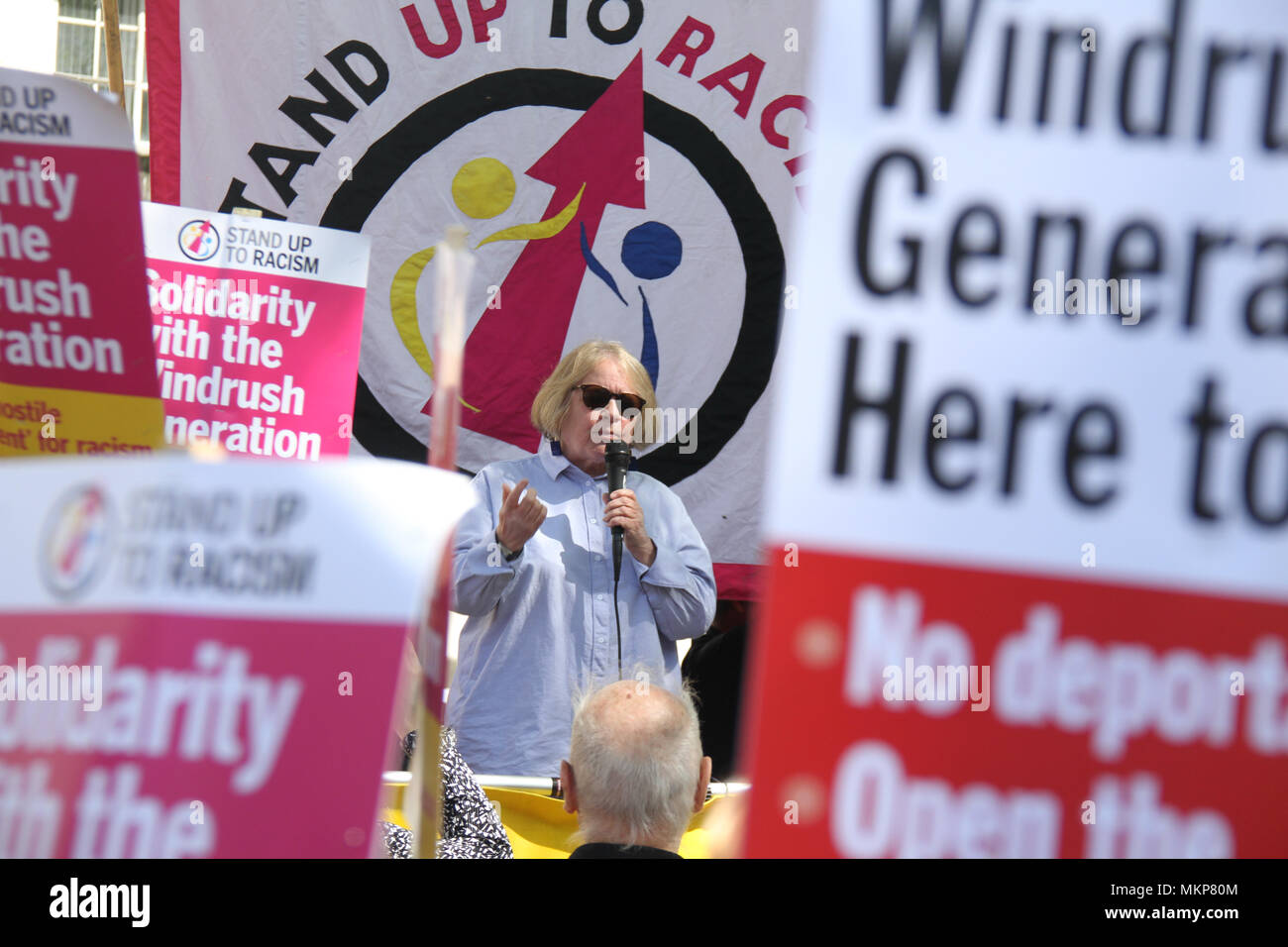"""Whitehall, London- UK: 5 May 2018. Lindsey German from Stop the War Coalition addresses  March for Windrush demonstrators at Whitehall on 5th May, to protest against the """"Hostile environment"""" that has targeted the Windrush generation. A generation of people who were invited from Commonwealth countries as UK citizens have been subject to deportation from  the UK. Credit: David Mbiyu /Alamy Live News - Stock Image"""