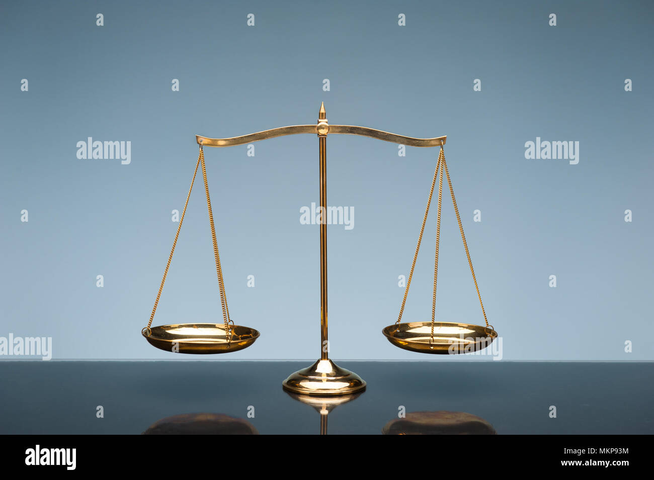 Golden Brass Balance Or Imbalance Scale On Blue Color Background