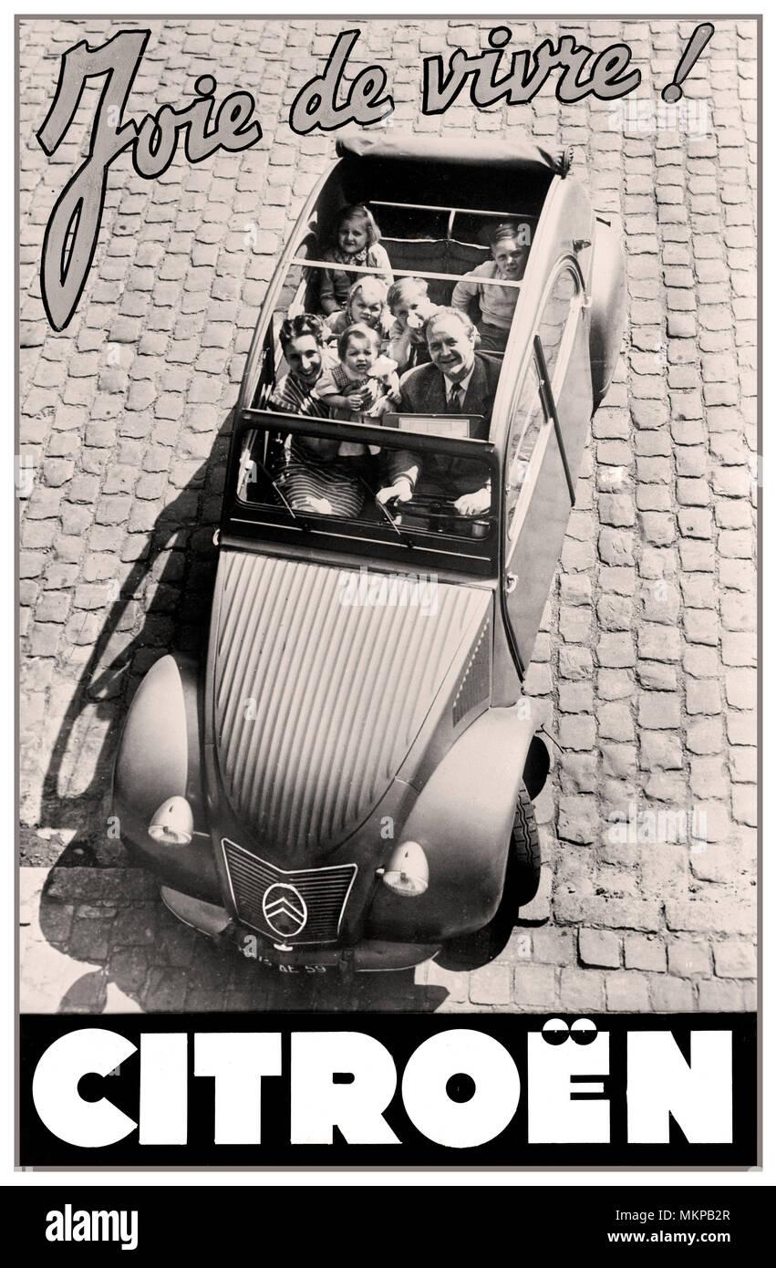Citroën 2CV 1959 'deux chevaux' typical notable family French car press advertising 'Joie de vivre'  The Joy of Life... - Stock Image