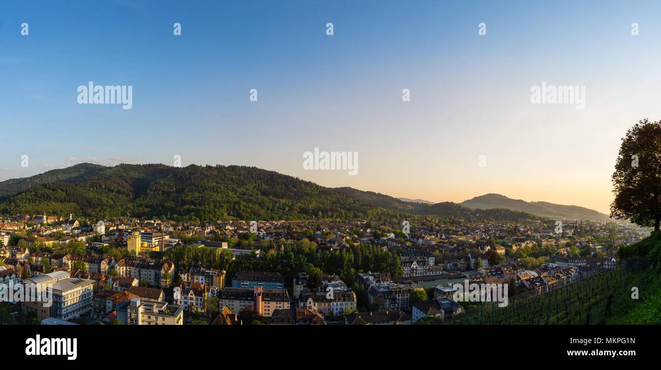 Germany, XXL panorama of city Freiburg im Breisgau at dawn in warm sunset light Stock Photo