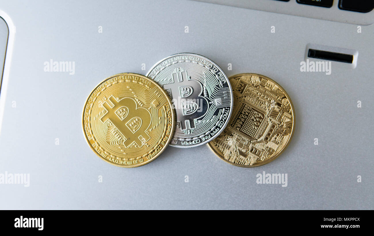 Golden and silver bitcoin coins on a laptop. Digital crypto currency. Virtual money. Metal coins of bitcoin. Bussiness, commercial, Exchange. Stock Photo