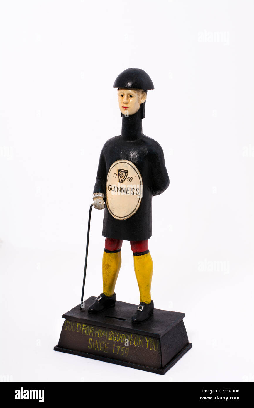 An iron mannikin mimicking a Guinness bottle with a collection box base, possibly a charity for wounded soldiers from many years ago. - Stock Image