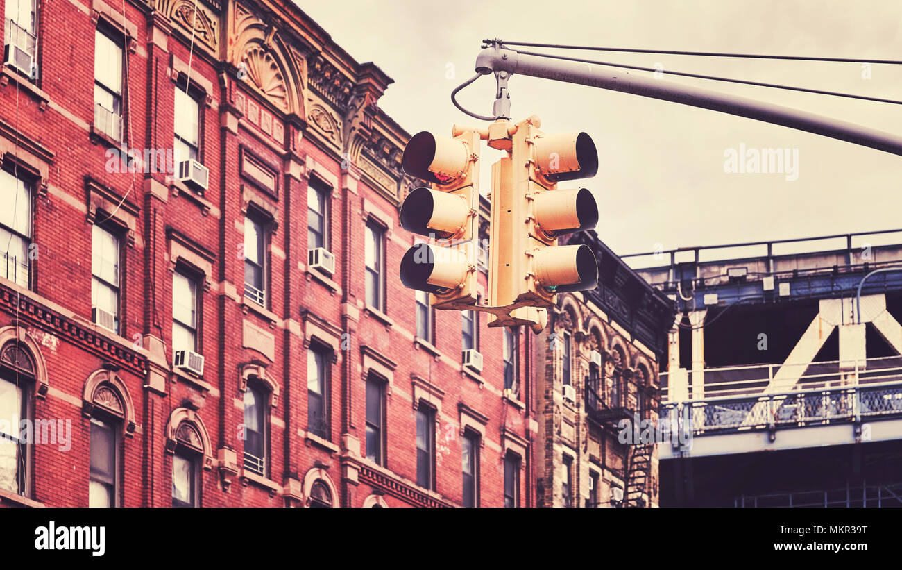 Retro toned picture of New York City traffic lights, selective focus, USA. - Stock Image