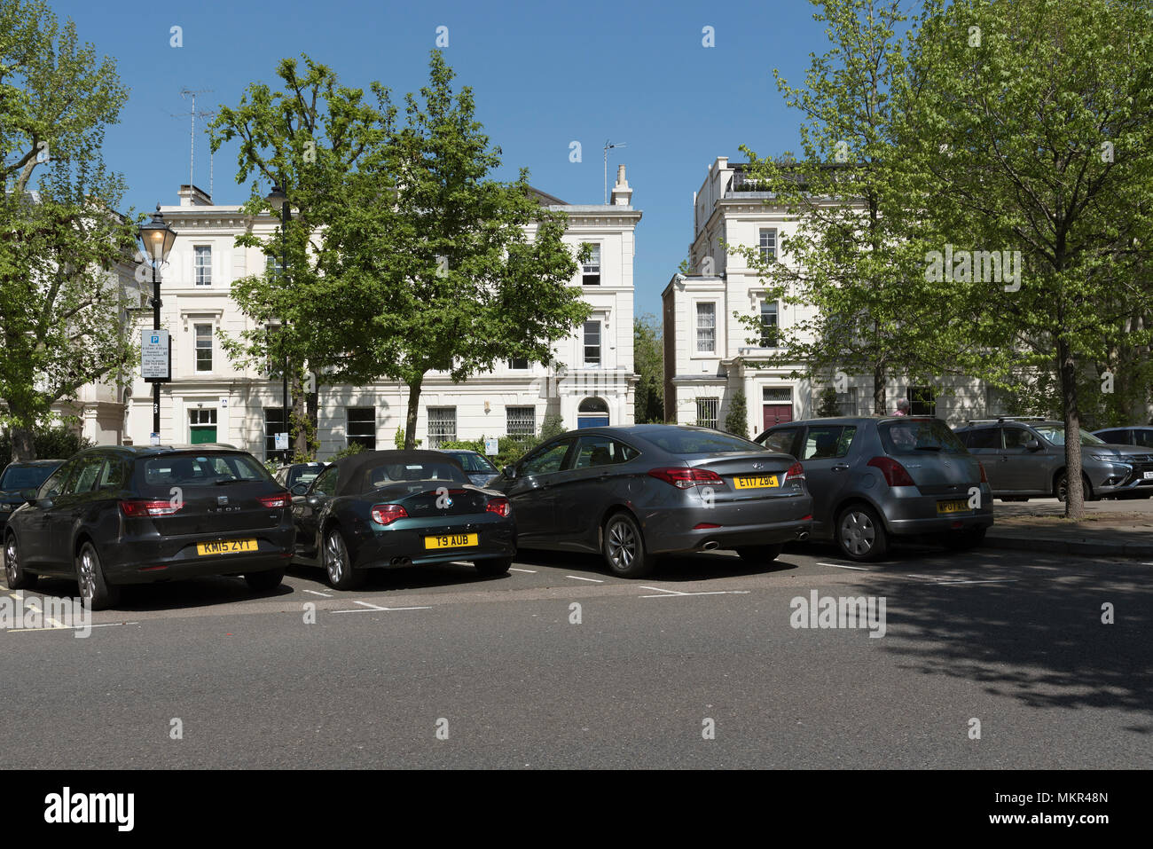 West London UK. 2018. A row of exclusive houses on Warwick Avenue with resident only parking bays, - Stock Image