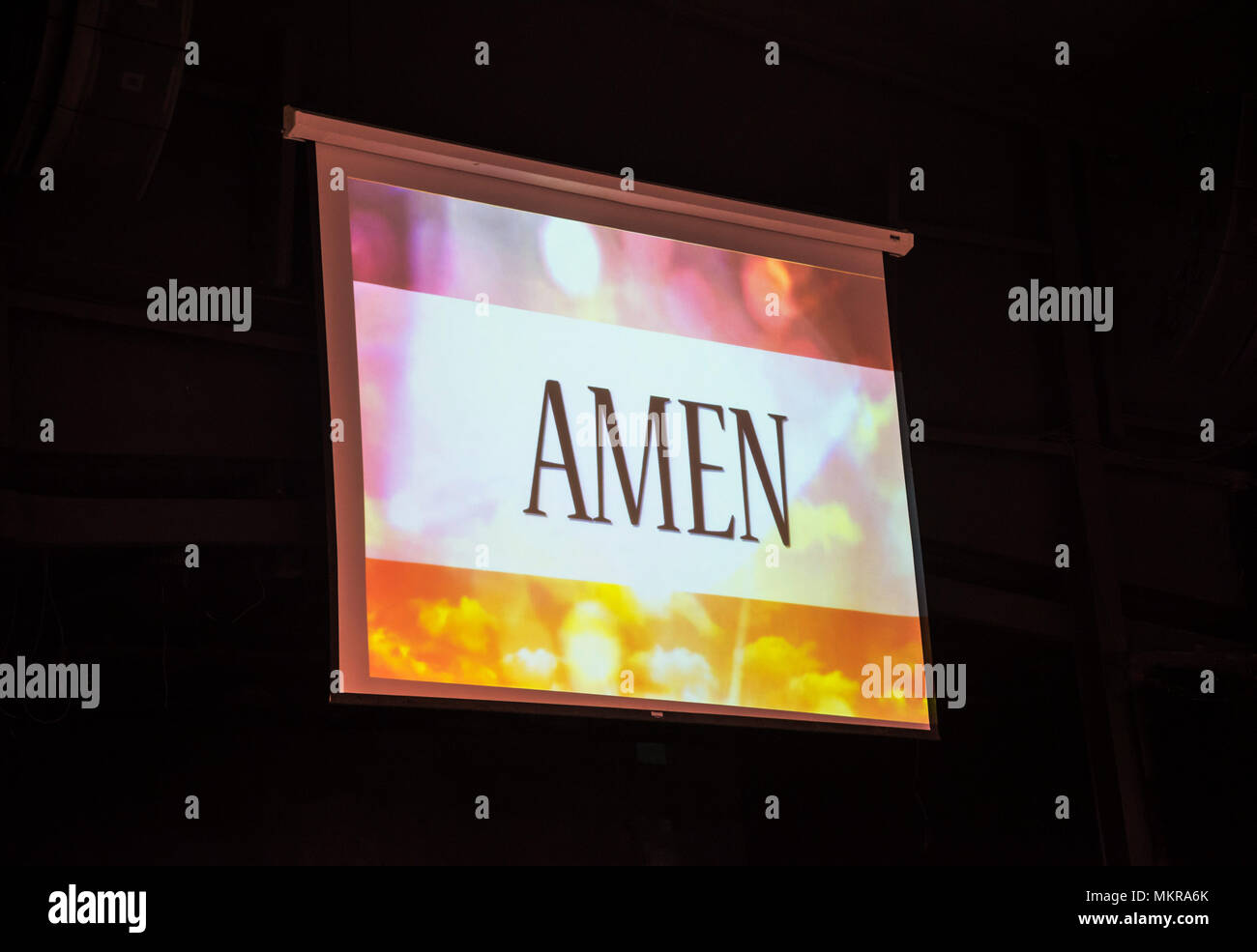 Amen sign projected onto a giant screen at a Baptist Church. - Stock Image