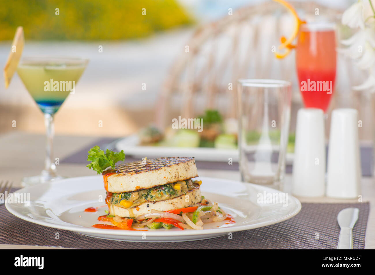 A plate of vegetarian burger at a high end outside restaurant - Stock Image