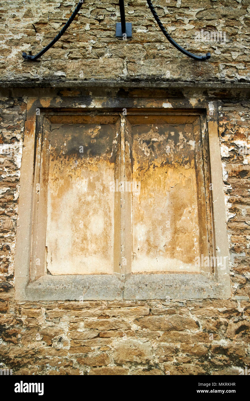 windows blocked up to avoid the window tax where the phrase daylight robbery comes from Lacock village wiltshire england uk Stock Photo