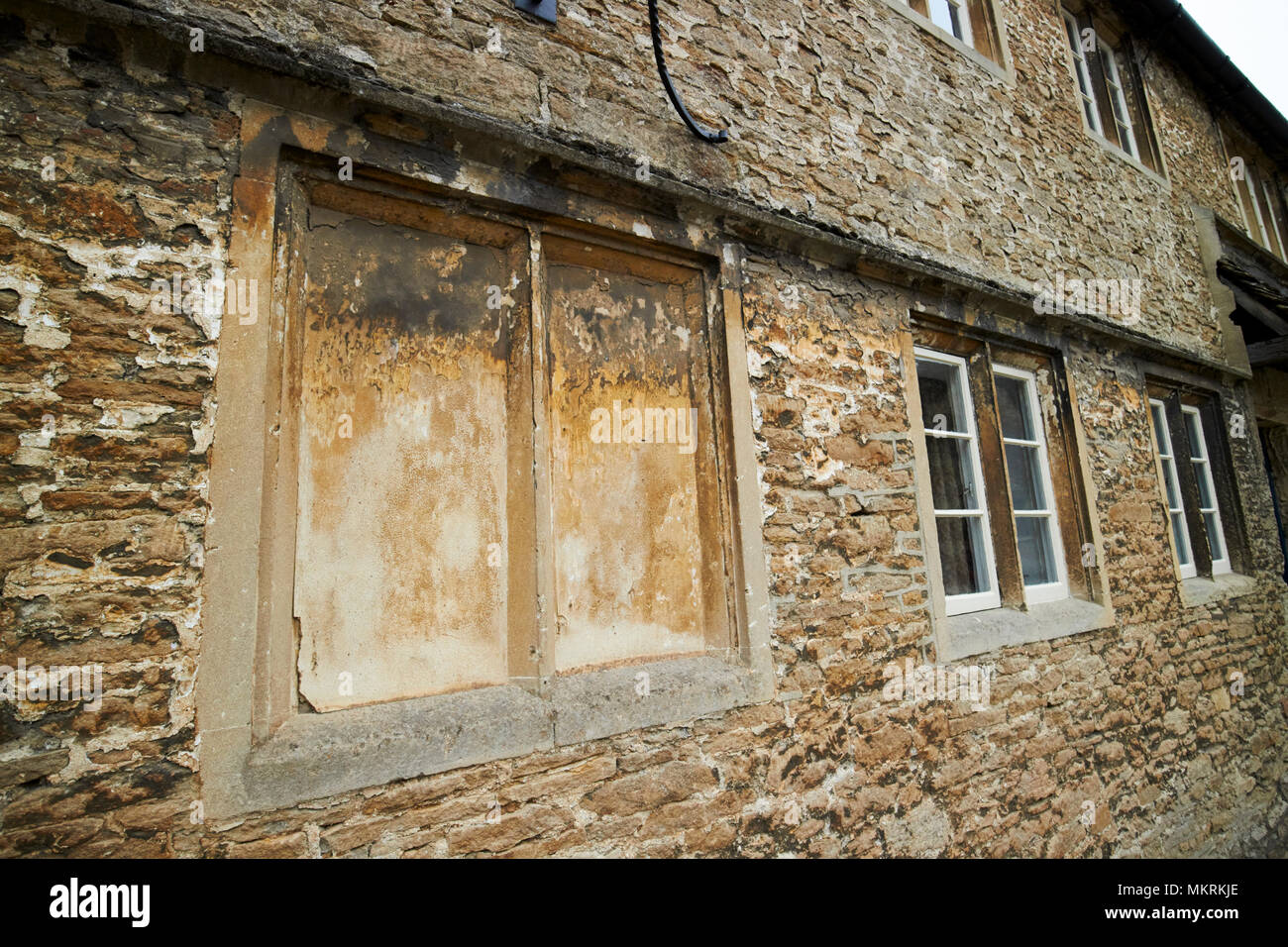 windows blocked up to avoid the window tax where the phrase daylight robbery comes from Lacock village wiltshire england uk - Stock Image