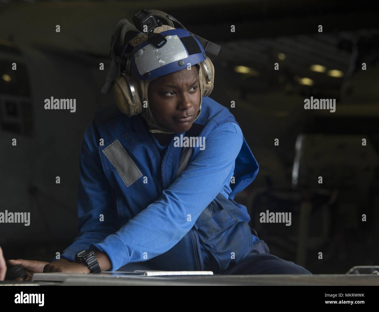 180507-N-AH771-0021 U.S. 5TH FLEET AREA OF OPERATIONS (May 7, 2018) Aviation Boatswain's Mate (Handling) Airman Khalyne Jones, from Marshall, Texas, drives an AS-32A spotting dolly in the hangar bay aboard the Wasp-class amphibious assault ship USS Iwo Jima (LHD 7), May 7, 2018, May 7, 2018. Iwo Jima, homeported in Mayport, Fla. is on deployment to the U.S. 5th Fleet area of operations in support of maritime security operations to reassure allies and partners, and preserve the freedom of navigation and the free flow of commerce in the region. (U.S. Navy photo by Mass Communication Specialist 3 Stock Photo