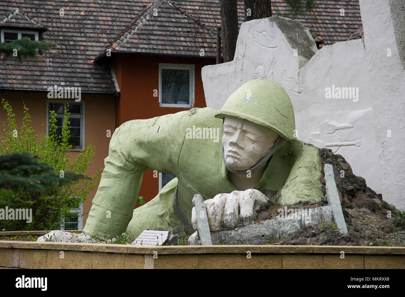 A monument of Soviet communications soldier in former location of the Soviet military communication garrison of Northern Group of Forces of Soviet Arm - Stock Image