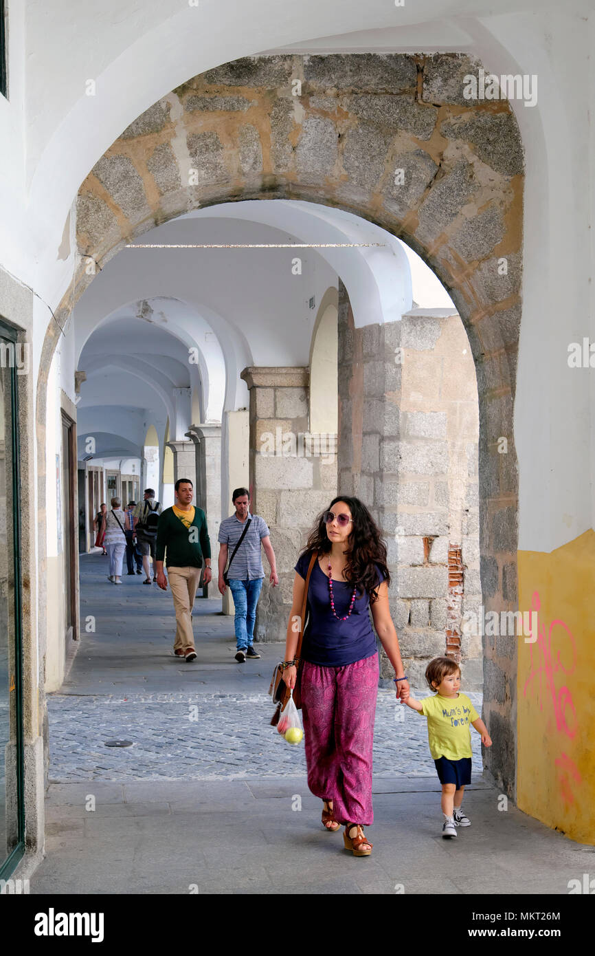 Archway / passage that goes along the main square Praca do Giraldo, Evora, Alentejo, Portugal - Stock Image