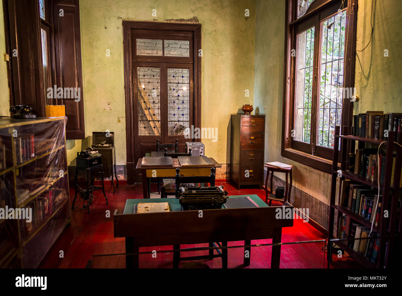 Office with desks and typewriters were Trotsky's secretaries and helpers worked, Leon Trotsky Museum, Coyoacan, Mexico City, Mexico - Stock Image