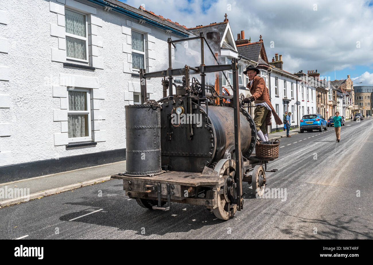 replica of richard trevithicks puffing devil steam locomotive on trevithick day in camborne, cornwall, england, britain, uk. - Stock Image