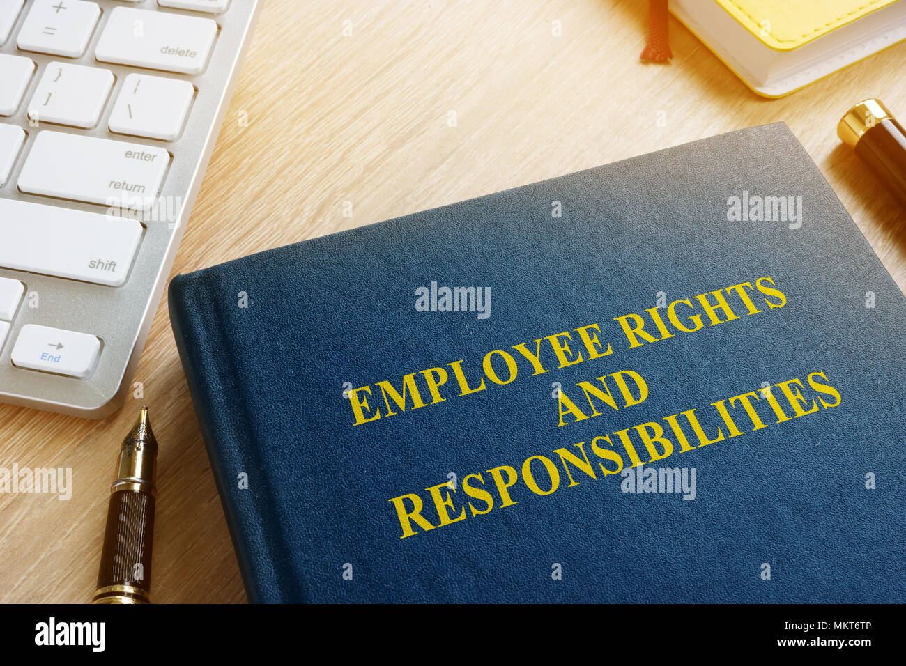 Book with title Employee rights and responsibilities. - Stock Image