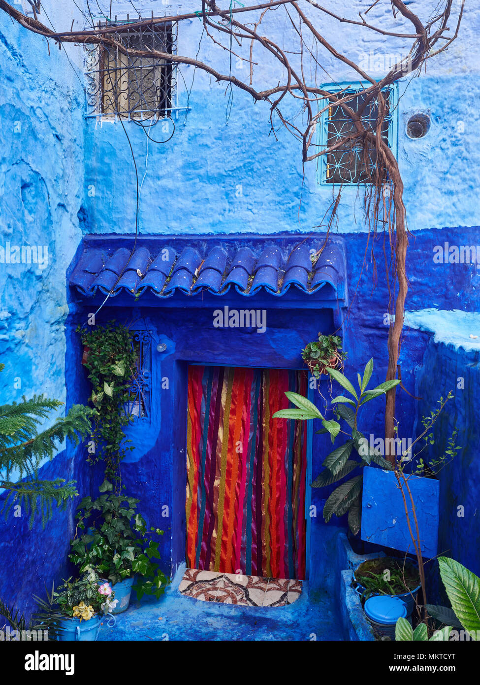 Bright Red Curtains In A Square Window On Blue Wall Chefchaouen Morocco