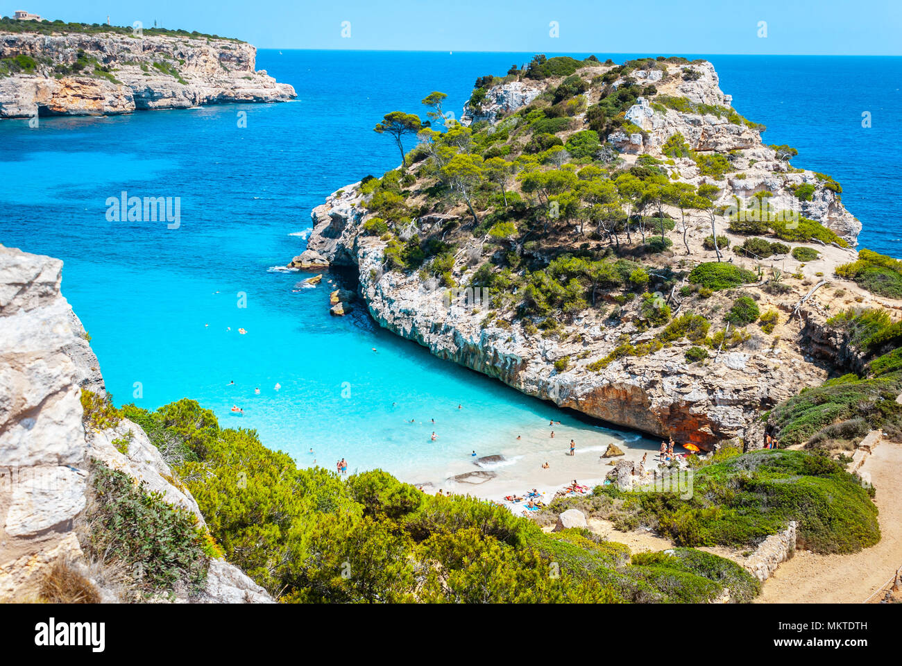 Calo des Moro, Mallorca on a sunny day with people on the beach - Stock Image