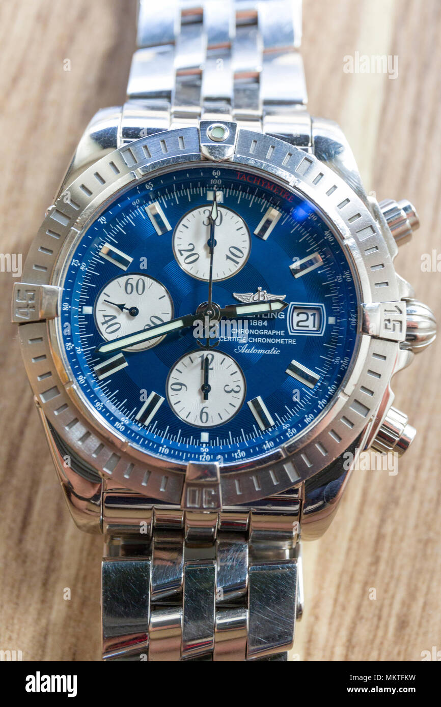 FLODA, SWEDEN – APRIL 21 2018: Close up view of high gloss stainless steel Breitling Chronomat Evolution blue watch face man's luxury watch  Model Release: No. Property Release: No. - Stock Image