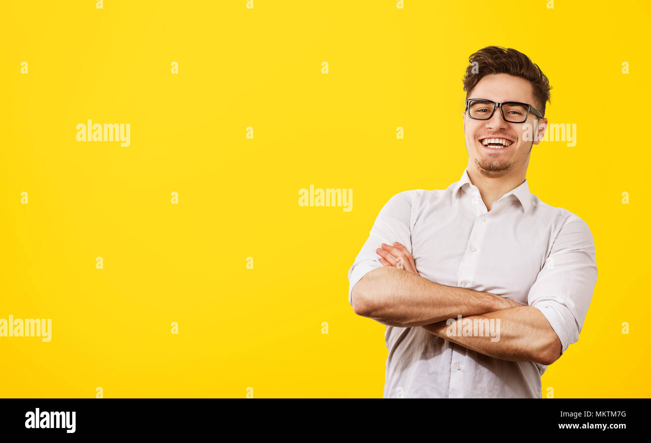 Portrait of glad handsome man with trendy hairdo and mustache, laughs happily at funny story, being in good mood, expresses positive emotions. Satisfi - Stock Image