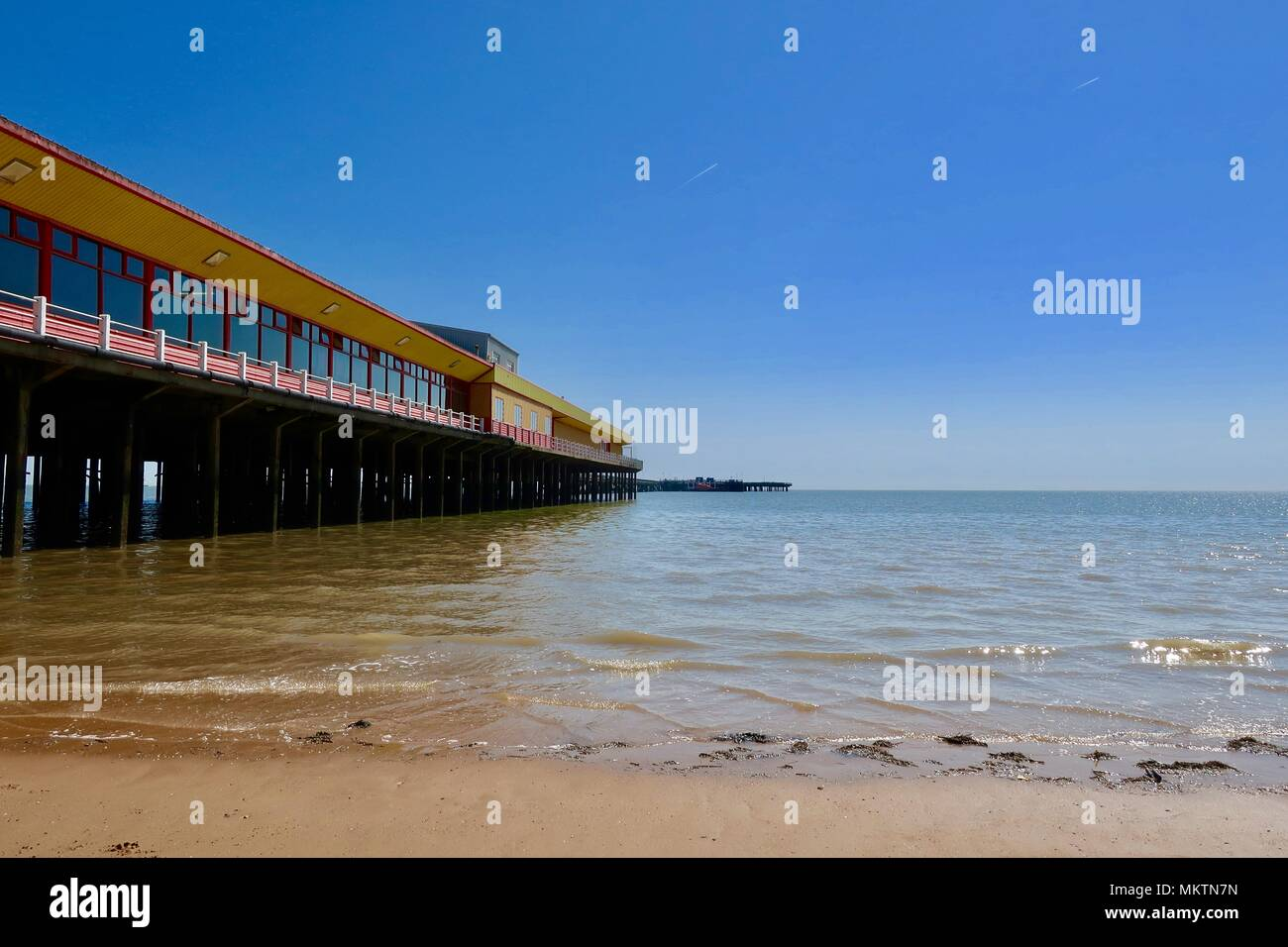 Pier at Walton on the Naze, Essex. Hot sunny spring day May 2018. - Stock Image