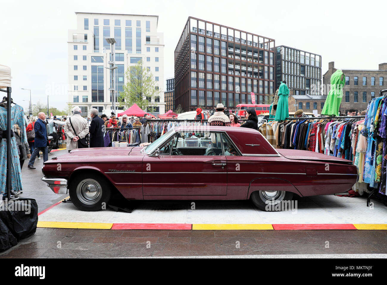 Vintage car boot sale and maroon Ford Thunderbird car at Granary Square street market in  Kings Cross London UK  KATHY DEWITT - Stock Image