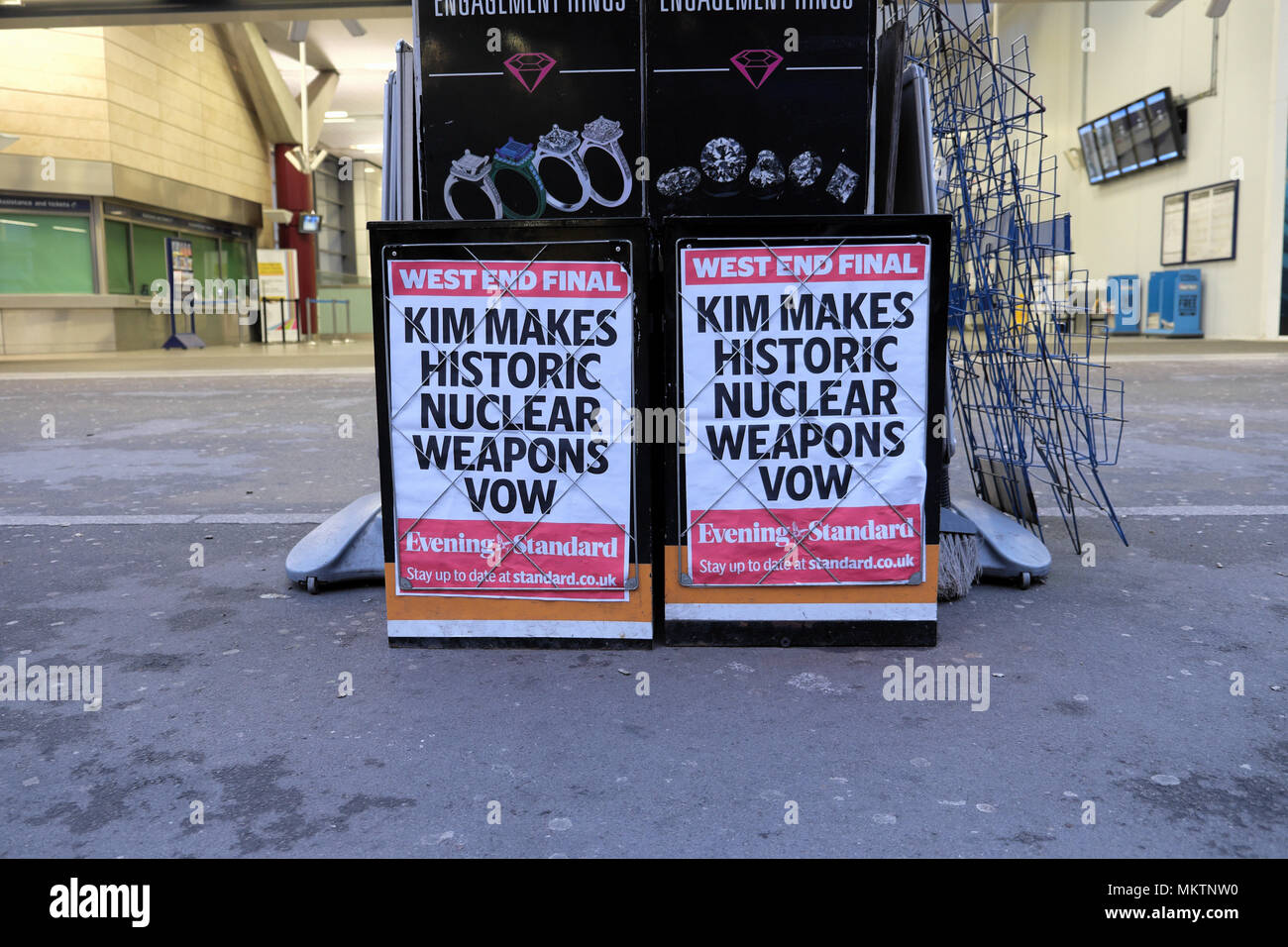 Evening Standard newspaper poster advert 'Kim Makes Historic Nuclear Weapons Vow'  outside a street news seller newsstand 28 April 2018 in London UK - Stock Image