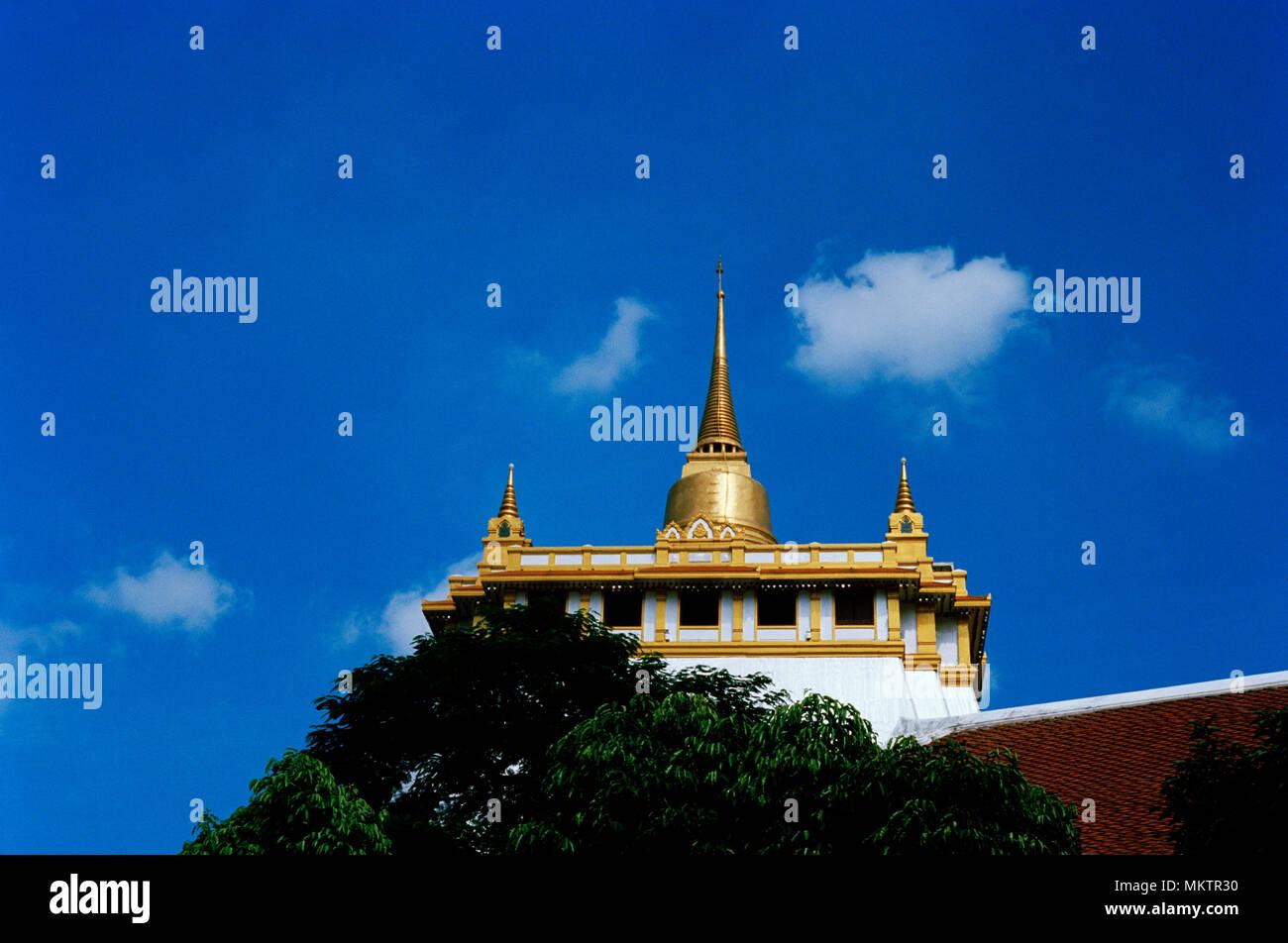Golden Mount - Buddhist shrine of Wat Saket Ratcha Wora Maha Wihan Golden Mountain Temple in Bangkok in Thailand in Southeast Asia Far East. Sky Stock Photo