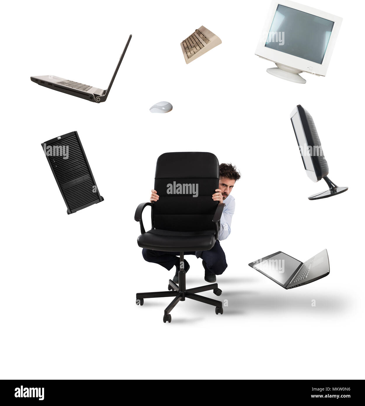 Businessman has fear of computers and technology - Stock Image
