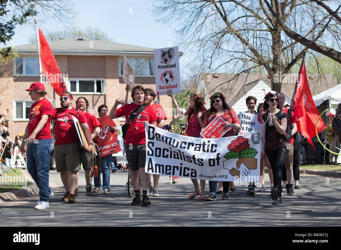 Democratic Socialists of America marching at the May Day parade and festival in Minneapolis, Minnesota, USA. - Stock Image