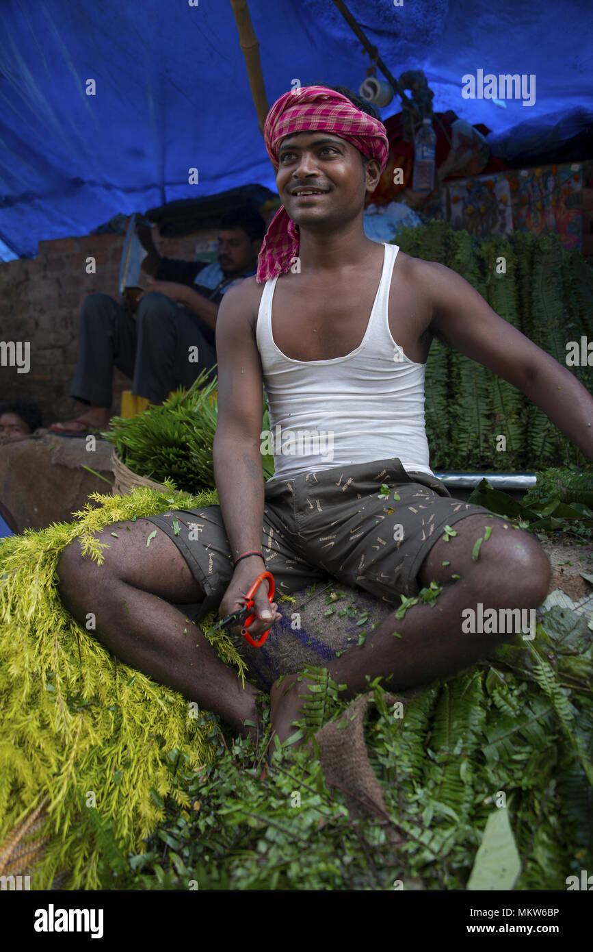 flower salesman at the Malik Ghat Flower Market in Kolkata, India - Stock Image
