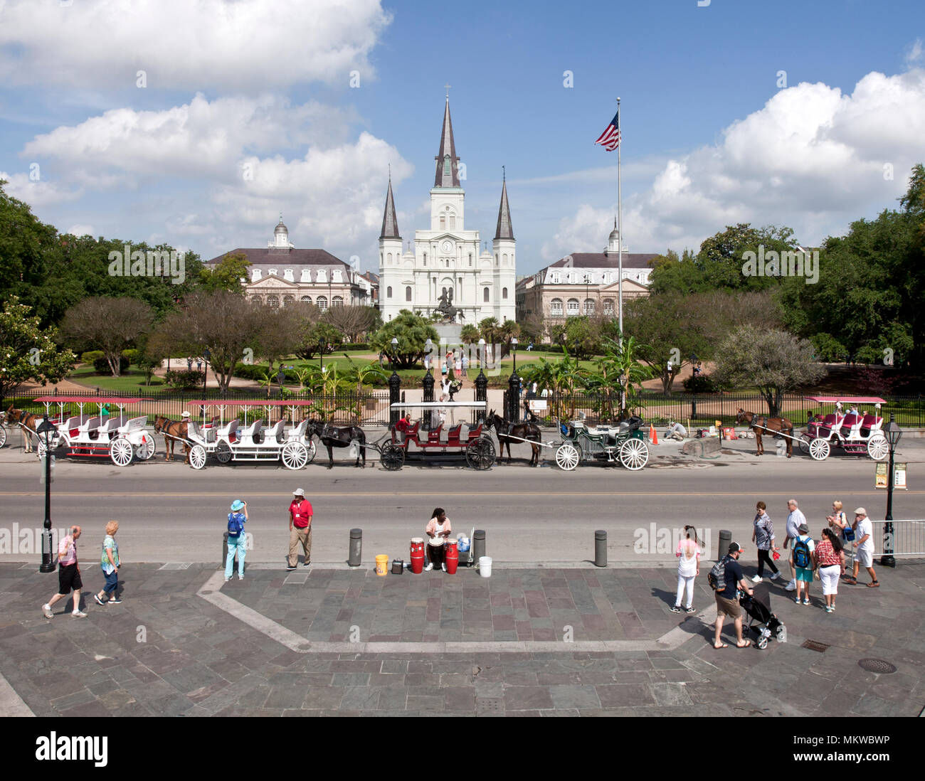 Decatur Street at Jackson Square, New Orleans, Louisiana. The bongo drummer in the lower center makes up rap about the people walking by. - Stock Image