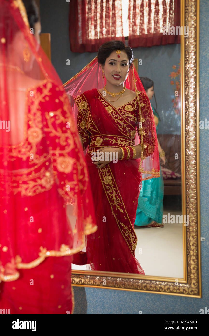 Beautiful Nepali Bride with wedding dress and make up at the
