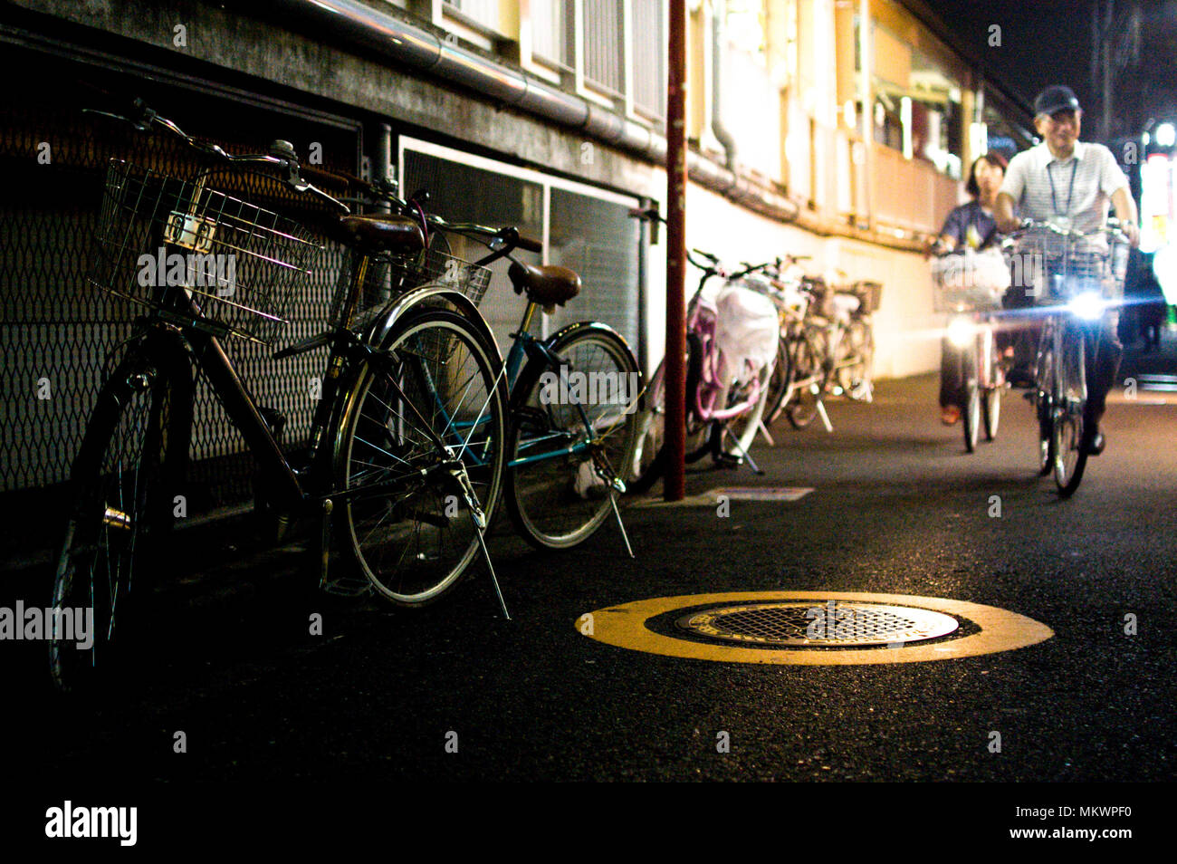Bicycles in Tokyo, Japan. Tokyo has many bicycles since the land is pretty flat. Many Japanese people ride bicycles as a transport. - Stock Image