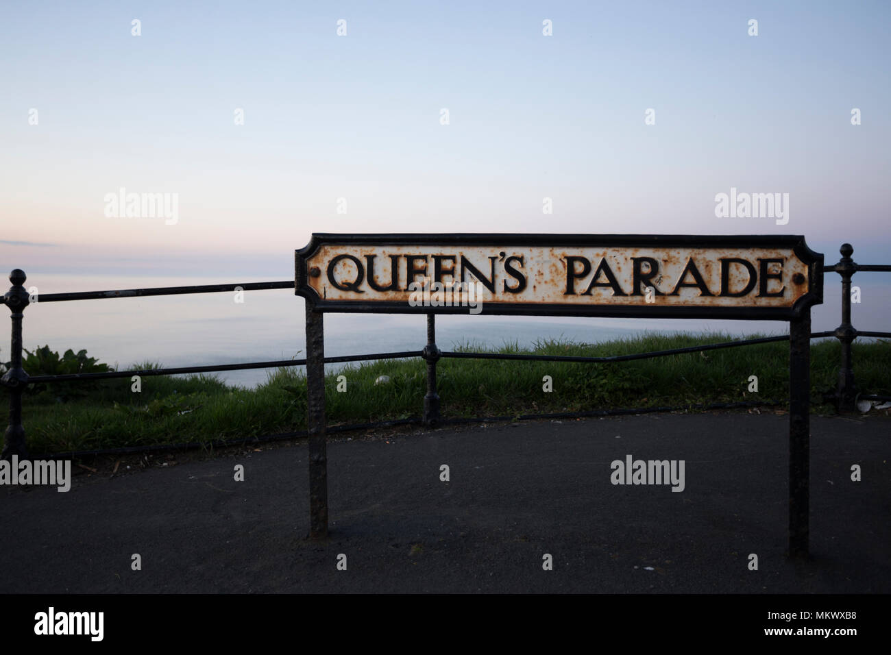 Queens Parade street sign in Scarborough , Yorkshire,UK.Overlooking the beautiful ocean. - Stock Image