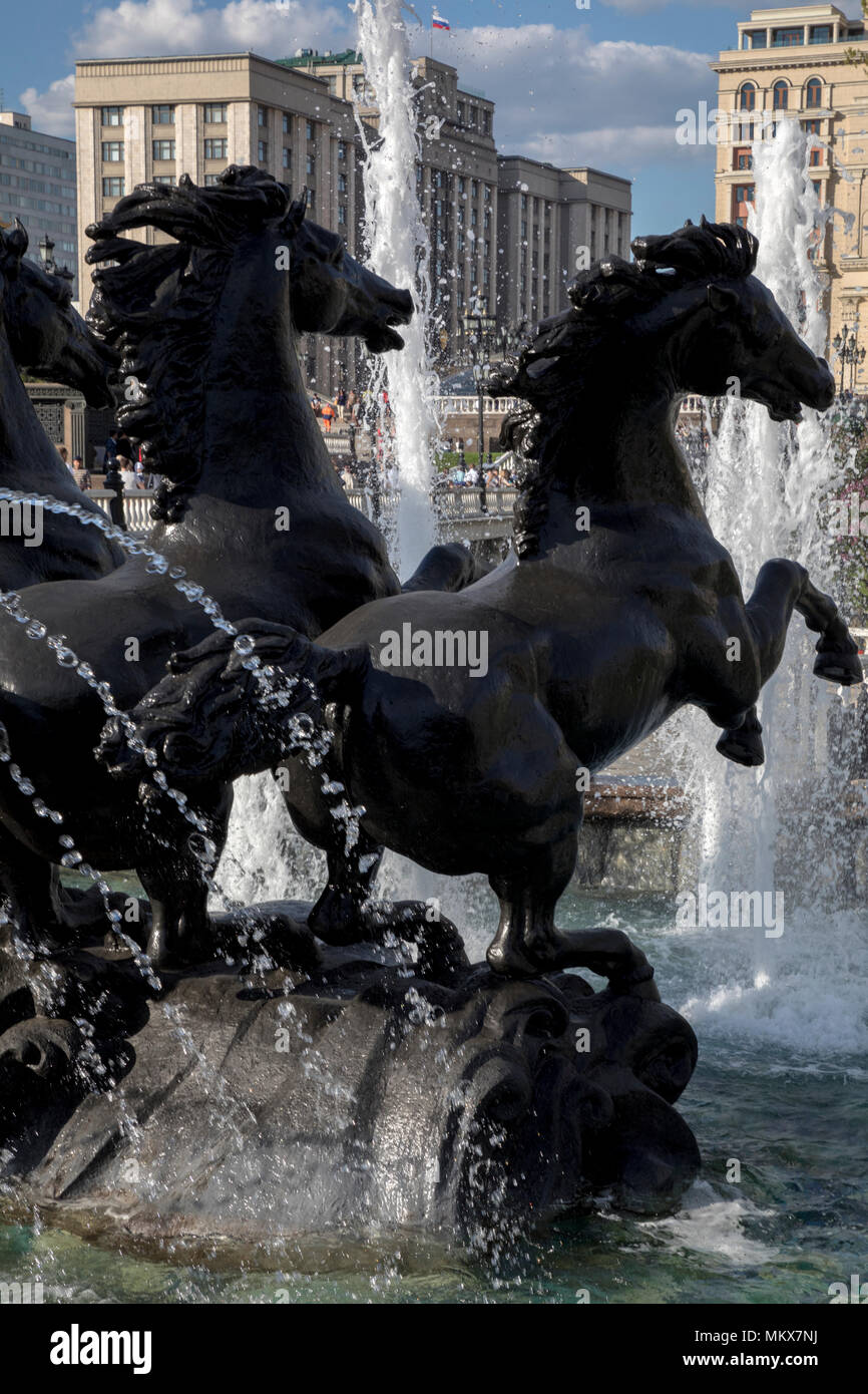 View of the sculpture group of four horses 'The Times of the Year' on Manege Square in the center of Moscow city, Russia - Stock Image