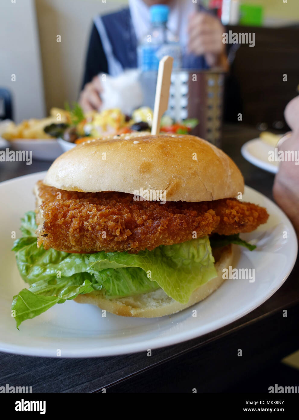 Chicken Schnitzel Burger On A White Plate Stock Photo Alamy