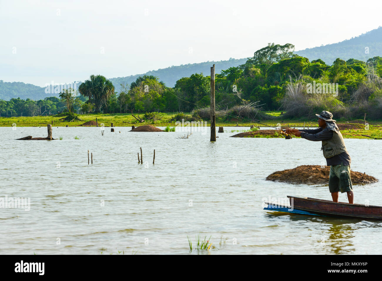 Chachoengsao, Thailand - December 8, 2011, Fisherman fishing by using fishing pole to fish in rural swamp in Chachoengsao, Thailand - Stock Image