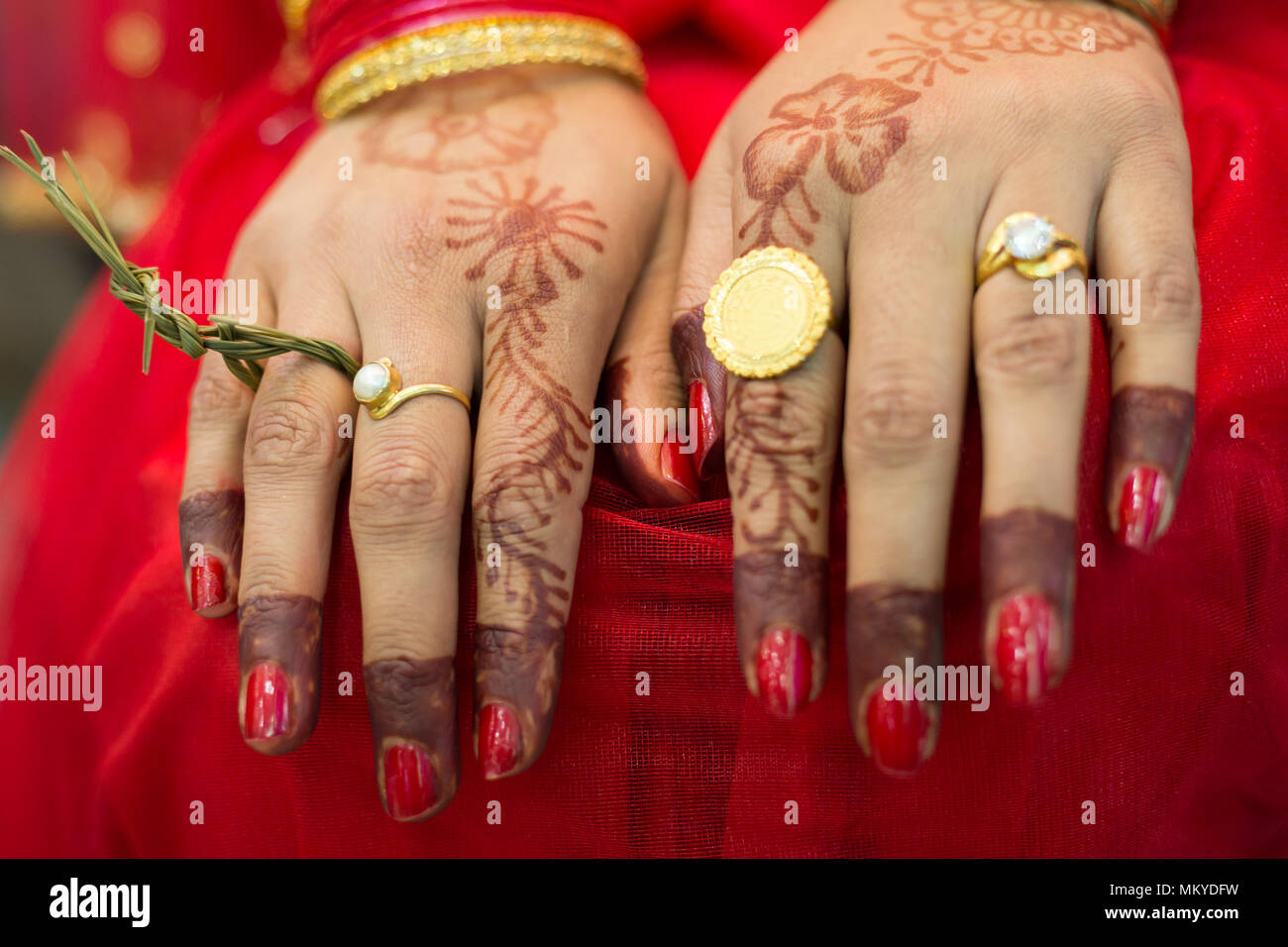 Hindu Nepali Brides Hands with wedding rings on the wedding day