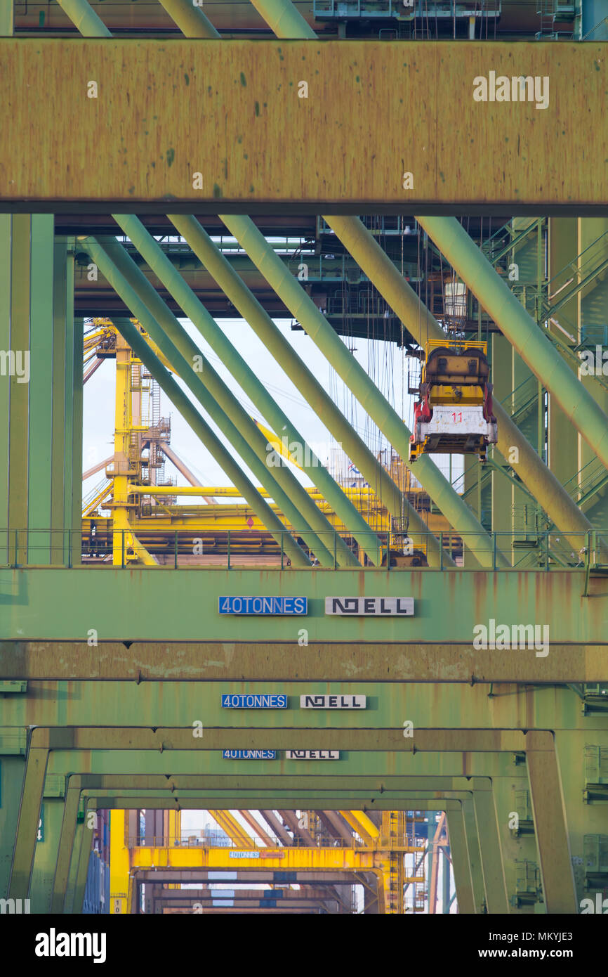 Close up picture of the container crane in lifting process - Stock Image