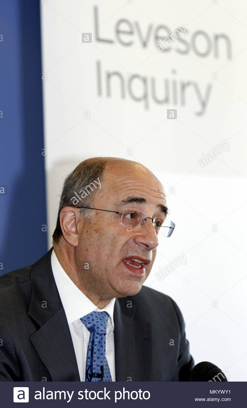 File photo dated 28/7/2011 of Lord Justice Leveson during the first formal phone hacking inquiry meeting at the QEII Centre in Westminster, London. MPs are due to vote on controversial measures to tighten press regulation, which critics fear could suffocate the free press. - Stock Image